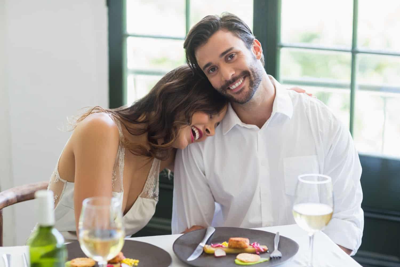 SB couple sharing romantic meal