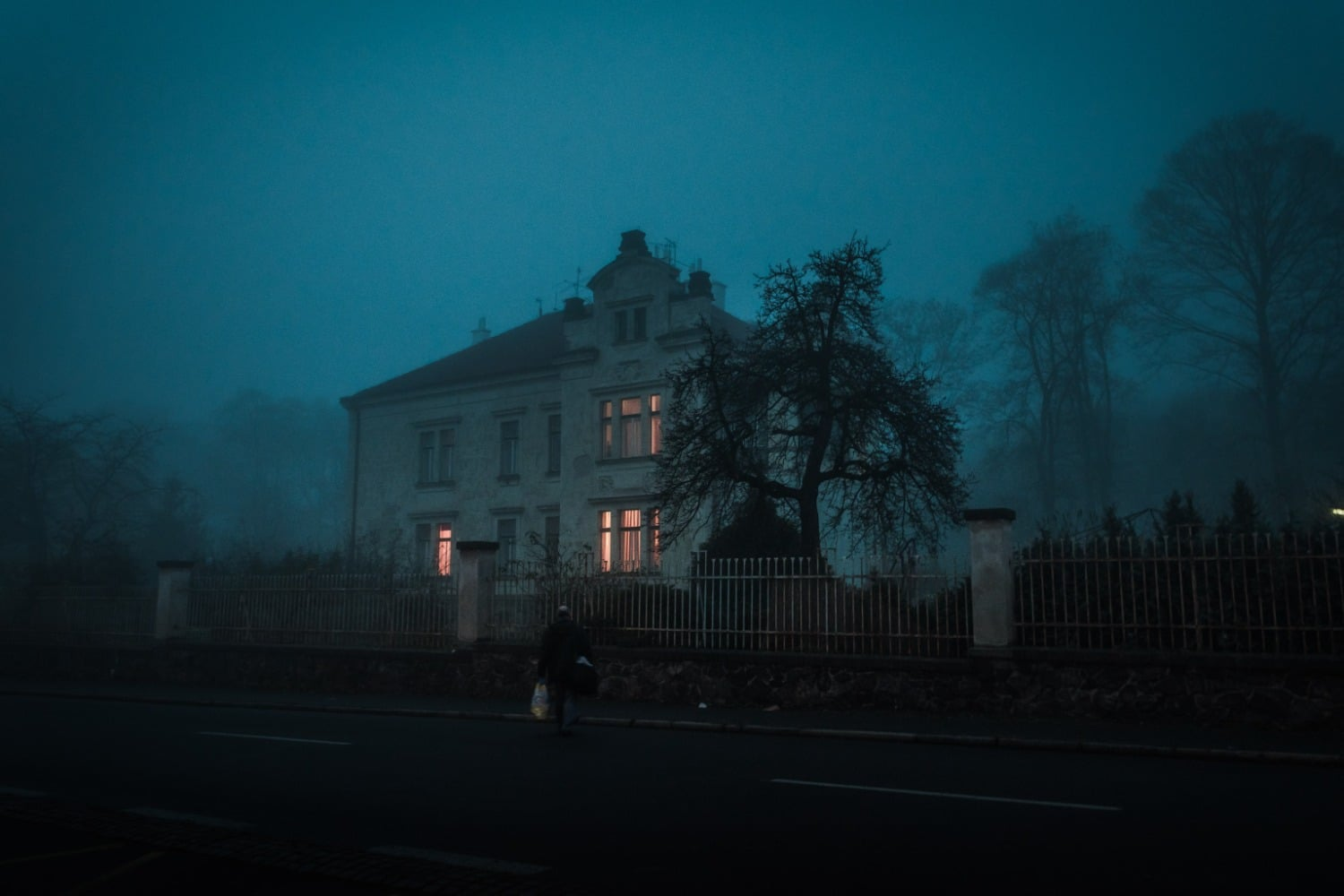 haunted house blue tone with lights on inside