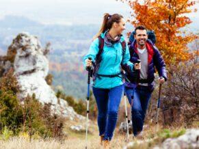 couple hiking fall leaves